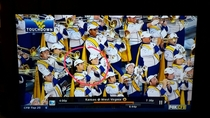 west virginia band member pretends to play trumpeteats sandwich instead