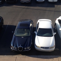 What to do when a Jaguar parks over two spots at the front in a busy lot White Nissan is me OC