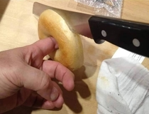 When cutting bagels in half put your finger trough the stabilization hole to keep it steady