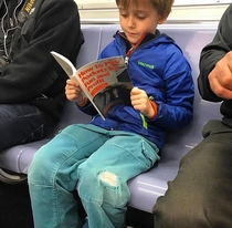 When your kid finally starts reading a book on subway rides instead of looking at his phone the whole time