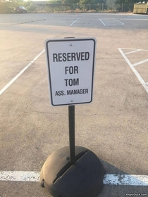 With a job title that awesome Tom definitely deserved a reserved parking spot