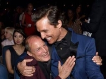 woody harrelson looks like a proud grandma hugging his grandson